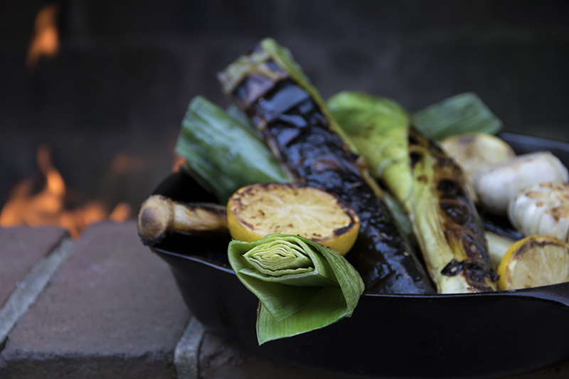 Blackened vegetables with a lemon for flavor